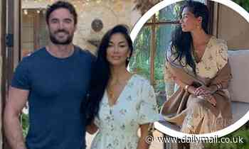 Nicole Scherzinger cosies up to beau Thom Evans... after confirming she wants children with him