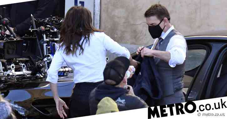 Tom Cruise and Hayley Atwell wear face masks as they are handcuffed together in close Mission Impossible 7