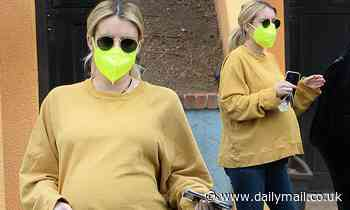 Pregnant Emma Roberts shows off her casual side in skinny jeans and a baby bump hugging sweatshirt