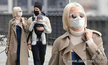 Michelle Williams and husband Thomas Kail take their bundle of joy for a family walk in NYC