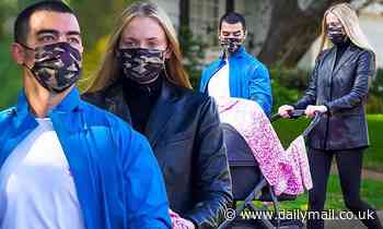 Joe Jonas and Sophie Turner wear matching camouflage masks as they take their daughter for a walk