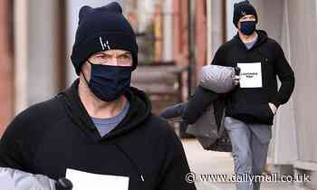 Hugh Jackman wears a face mask as he feels the chill in New York City