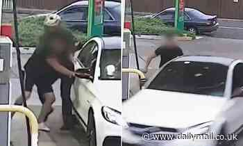 CCTV footage captures terrifying moment Mercedes driver is carjacked and threatened with a knife
