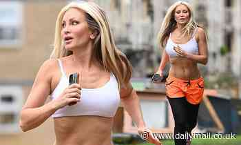 Caprice, 49, displays her enviable washboard abs in crop-top