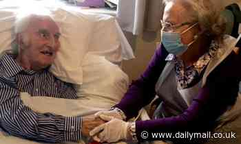 Couple hold hands for the first time in eight months after care home Covid rules kept them apart