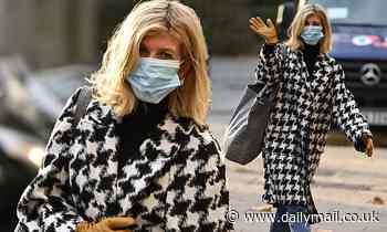 Kate Garraway looks chic in a houndstooth coat as she leaves work