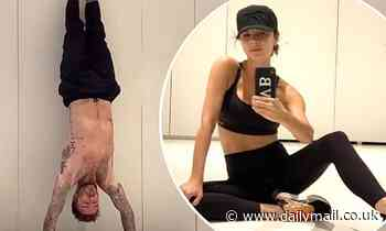 Victoria Beckham films shirtless husband David's VERY impressive handstand