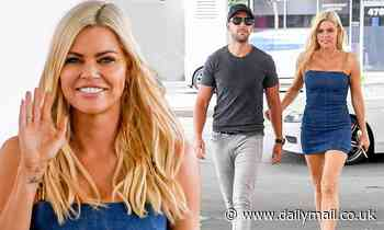 Sophie Monk looks sensational in a skintight denim dress for petrol stop
