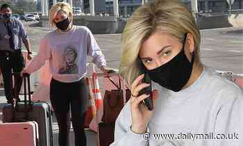 Savannah Chrisley looks stylish in graphic sweater and leggings as she arrives to LAX