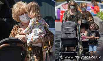 Patti Newton looks downcast as she steps out in Melbourne as husband Bert recovers in hospital