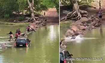 Northern Territory family make a treacherous crossing over crocodile-infested Cahills Crossing