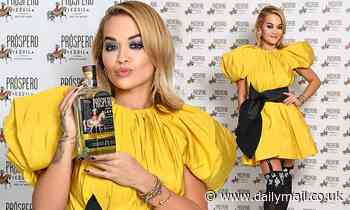 Rita Ora dazzles in canary yellow mini dress paired with crystal-adorned suspenders