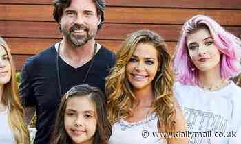Denise Richards looks radiant as she poses for family holiday card with husband and daughters