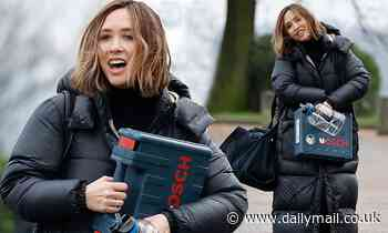 Dancing On Ice's Myleene Klass bundles up in a long padded coat as she cheerfully leaves training