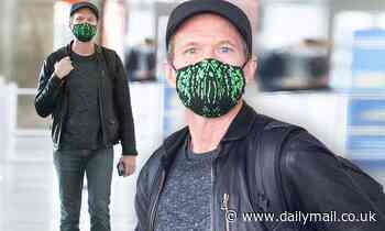 Neil Patrick Harris wears a cool black leather jacket as he touches down in NYC's JFK airport