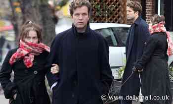 Helena Bonham Carter and beau Rye Dag Holmboe take their dogs for a walk