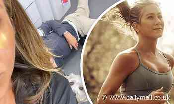 Jennifer Aniston shares image of a mystery man laying on the floor with her dog Clyde nearby