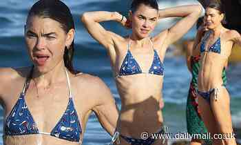 Bambi Northwood-Blyth flaunts her slender frame in a minuscule string bikini