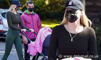Sophie Turner enjoys her daily walk with husband Joe Jonas and their daughter Willa, four months
