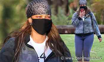 Tyra Banks enjoys a casual stroll in the park after wrapping Dancing with the Stars hosting duties
