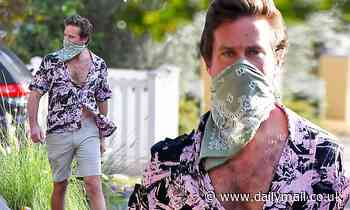 Armie Hammer keeps his shirt unbuttoned as he steps out in Los Angeles