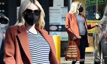 Emma Roberts wraps her baby bump in nautical stripes as she runs last-minute Thanksgiving errands