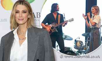 Delta Goodrem performs with her boyfriend Matthew Copley in Sydney