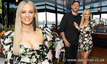 Samantha Jade shows off her pins as she poses with her fiancé at the launch party for her new single
