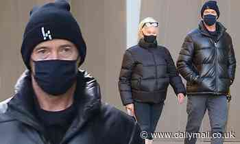 Hugh Jackman happily coordinates with wife Deborra-Lee Furness in matching black puffer jackets