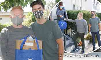 Jesse Tyler Ferguson and Justin Mikita hand out meals ahead of Thanksgiving