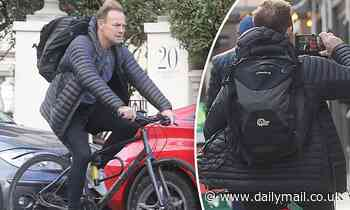 Jason Donovan braves chill as he snaps selfies riding to Dancing on Ice training session