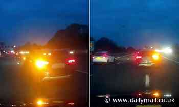 Moment two reckless drivers swerve across busy motorway during rush hour in row over lane 'hogging'