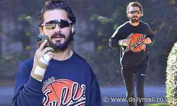 Shia LaBeouf appears to have a tense phone call before heading out for a jog