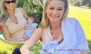 Anna Heinrich breastfeeds daughter Elle as she catches up with local mothers' group