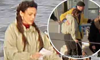 Michelle Keegan rehearses her lines before hugging a crew member during Brassic filming