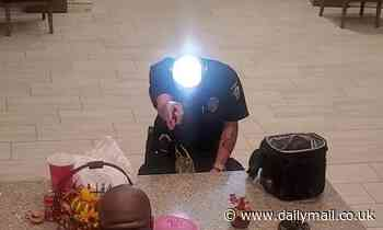 Taking a shine! Man uses a torch to turn his bald head into a dazzling mirror