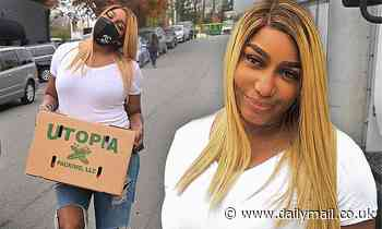 RHOA veteran NeNe Leakes wears a Chanel mask as she gives away Thanksgiving dinners