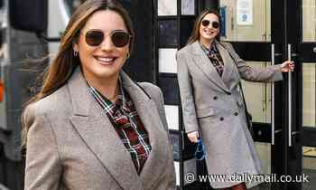 Kelly Brook beams in checked shirt and tweed coat