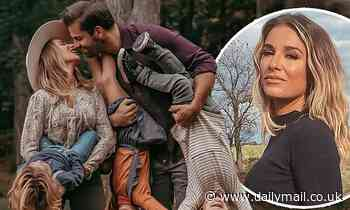 Jessie James Decker and husband Eric share a sweet kiss as they hold their three kids upside down