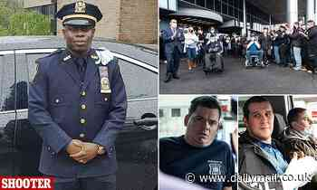 Two NYPD cops who were shot are discharged from hospital to hero's welcome