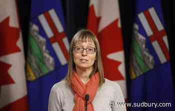Alberta's chief medical health officer says she doesn't dictate policy decisions