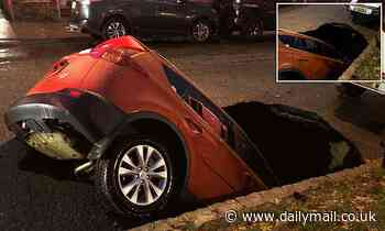 Huge sinkhole opens up on a New York street and swallows up a car