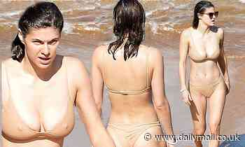 Alexandra Daddario stuns in a beige bikini at the beach with her costar Steve Zahn