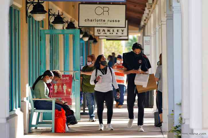 Virus keeps Black Friday crowds thin, shoppers shift online