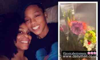 Niecy Nash is greeted with flowers from wife Jessica Betts as they celebrate first Thanksgiving