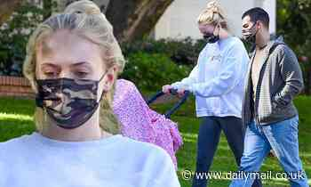 Sophie Turner urges 'empathy' in a sweatshirt while on a walk with Willa and Joe Jonas in LA
