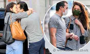 Katie Holmes steals kiss for road from boyfriend Emilio Vitolo Jr in NYC as she heads out of town