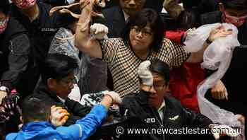 Taiwan MPs throw pig guts at premier | The Star | Newcastle, NSW - Newcastle Star