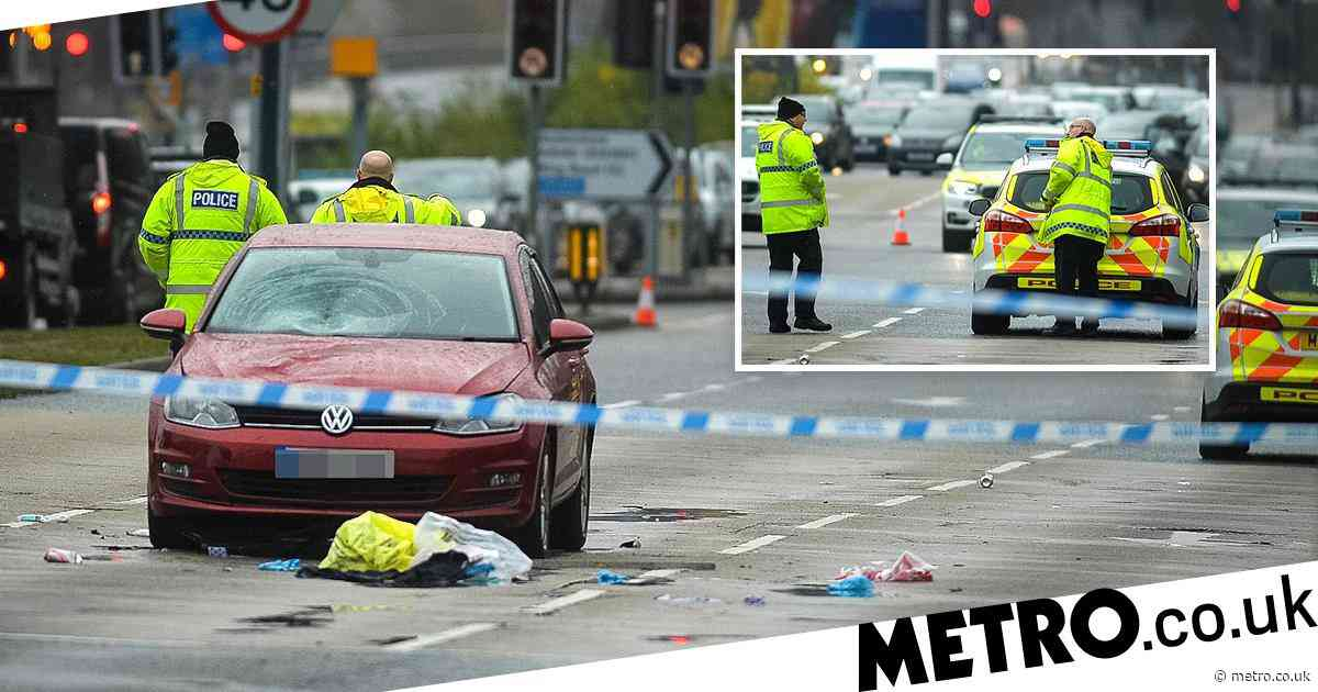 Driver arrested after collision leaves woman dead and man fighting for life