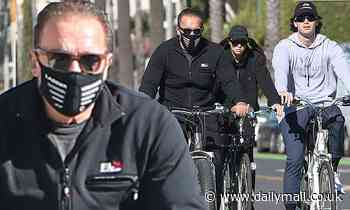 Arnold Schwarzenegger and his kids Patrick and Christina take a family bike ride